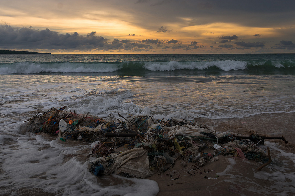 "Beautiful Bali. ""Plastic bags, bottles and other trash entangled in spent fishing nets litter the potentially beautiful Jimbaran beach on the island of Bali, Indonesia."" Image by killerturnip, Flickr.com"