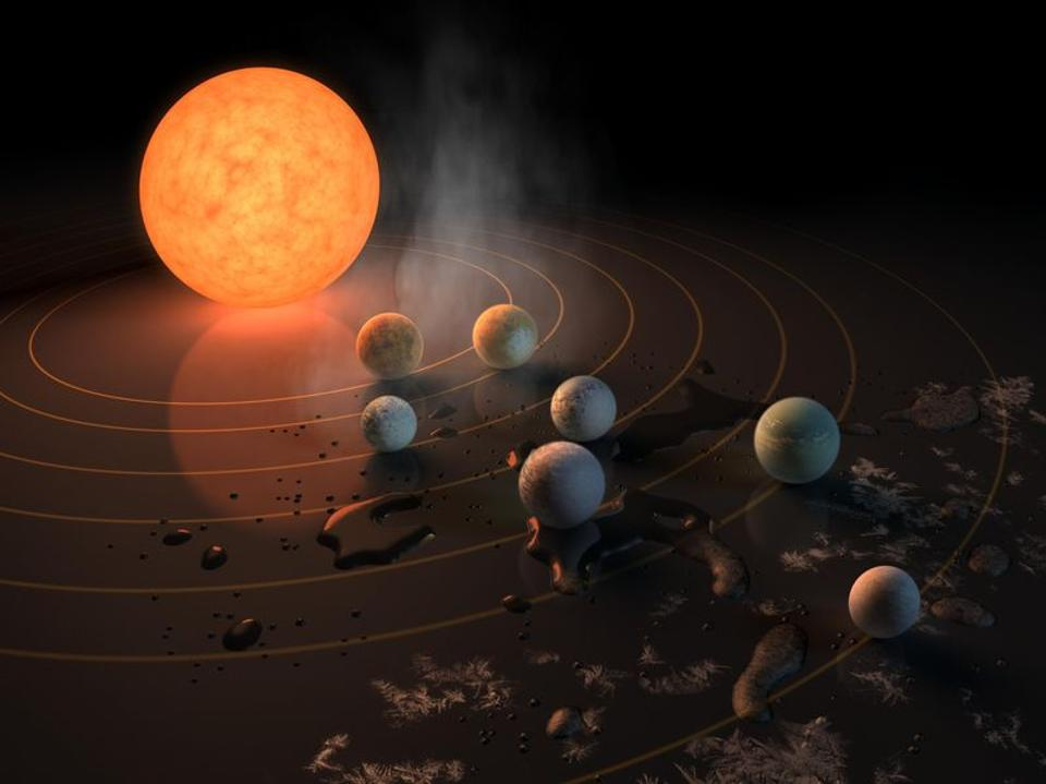 Artist concept drawing of TRAPPIST-1, a star with seven Earth-size planets orbiting it. Credit: NASA/JPL-Caltech.